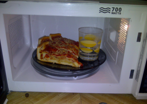 Put a glass of water in the microwave with pizza so it doesn't get chewy.